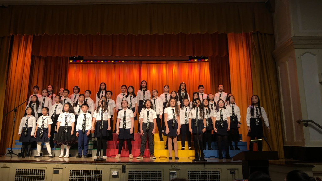 Chorus singing during their set